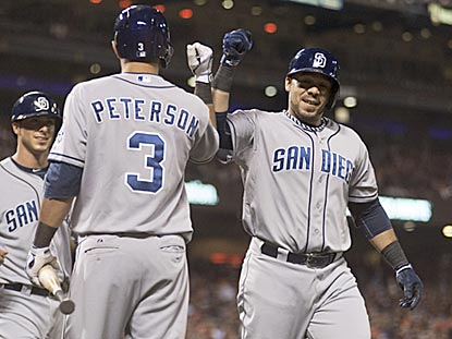 Rene Rivera celebrates with third baseman Jace Peterson after hitting a three-run homer in the fifth inning.  (USATSI)