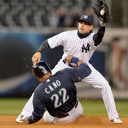 Robinson Cano beats the tag from New York's Brian Roberts to steal second base in the seventh inning. (USATSI)