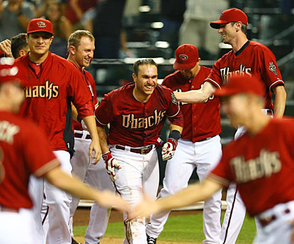 Arizona players congratulate Miguel Montero after he hit a walk-off homer in the 10th against the Rockies. (USATSI)