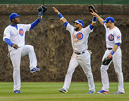 Cubs outfielders Emilio Bonifacio, Nate Schierholtz and Junior Lake are all smiles after the Cubs knock off St. Louis. (USATSI)