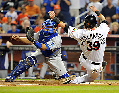Jarrod Saltalamacchia slides past Miguel Olivo's tag at the plate to score in the Marlins' 6-3 win over the Dodgers. (USATSI)