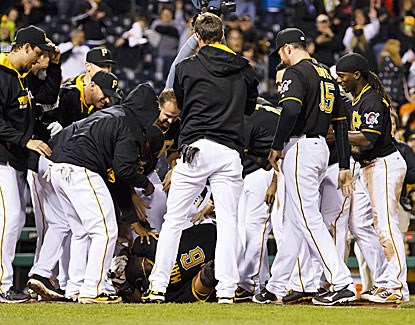Pittsburgh's Starling Marte is at the bottom of the pile after hitting the winning home run in the ninth against Toronto. (USATSI)