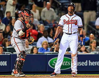 Justin Upton doesn't appear very happy about striking out in the ninth inning of the Braves' loss to San Francisco. (USATSI)