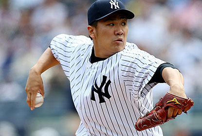 Masahiro Tanaka allows eight hits in seven innings, but the offense helps him extend his unbeaten streak to 40 starts. (Getty Images)