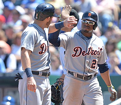 Ian Kinsler (left) and Rajai Davis celebrate after scoring on Miguel Cabrera's double during Detroit's three-run fourth inning. (USATSI)