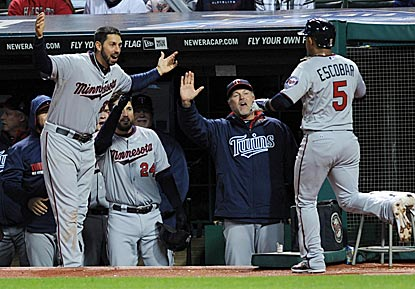 Eduardo Escobar gets a hearty welcome upon reaching the Twins dugout after his deciding home run in the 10th inning.  (USATSI)