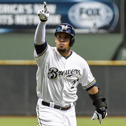 Carlos Gomez reacts to his home run in the first inning in his usual understated manner.  (USATSI)