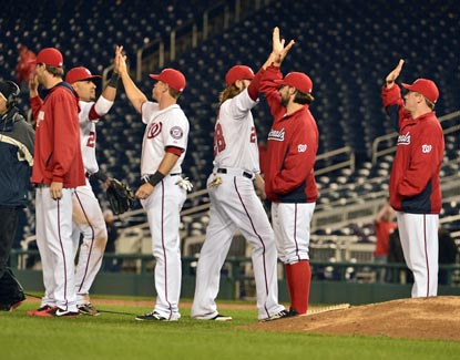 At 1:21 a.m. ET in a near-empty stadium, the Nationals finally put a cap on a soggy victory.  (USATSI)