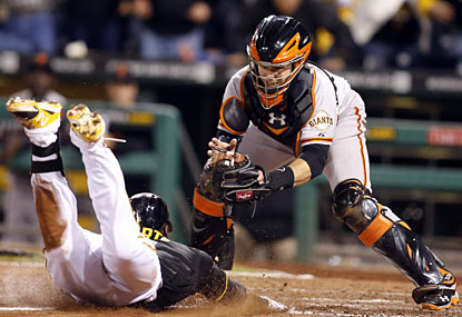 Starling Marte slides into home, beating a tag by Giants catcher Buster Posey for the winning run. (USATSI)