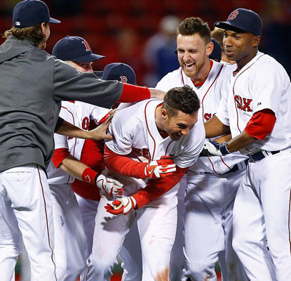 Grady Sizemore gets plenty of love from his Boston teammates after he delivers the winning RBI in the 12th. (Getty Images)