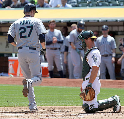 Corey Hart opens up the second inning with a solo shot off Dan Straily to give the Mariners the early lead. (USATSI)