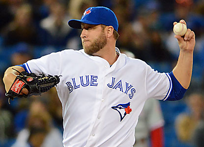 Mark Buehrle (6-1) yields three hits and strikes out six in seven innings as his Jays shut out the Phillies. (USATSI)