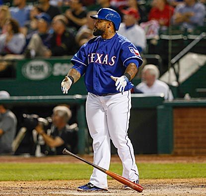 Prince Fielder admires his solo home run in the sixth inning, which pushes Texas' lead to 3-0.  (USATSI)