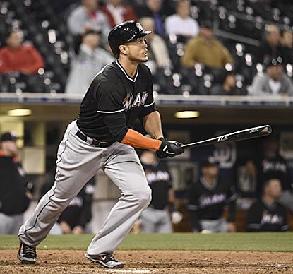 Giancarlo Stanton drives an 0-2 fastball to center field in the 11th inning that adds to his NL-leading HR and RBI totals.  (Getty Images)