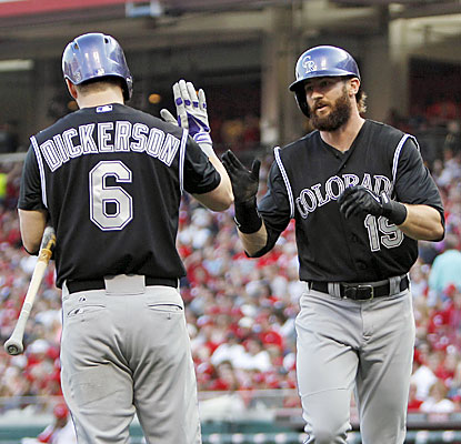 Corey Dickerson and Charlie Blackmon combine for seven hits, three homers, 6 RBI and six runs in the rout. (USATSI)