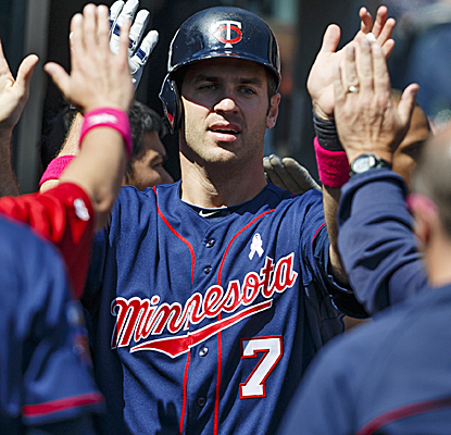 Joe Mauer and the Twins put up three runs in the eighth inning to spoil a quality start by Detroit's Robbie Ray.  (USATSI)