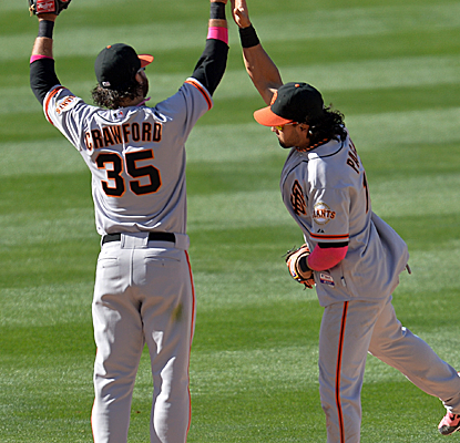 After letting a two-run lead slip in the ninth, the Giants answer with three in the 10th to beat the Dodgers.  (USATSI)