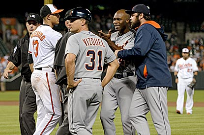 Torii Hunter is held back after being hit by a pitch in the eighth inning. The benches clear, but no punches are thrown.  (Getty Images)