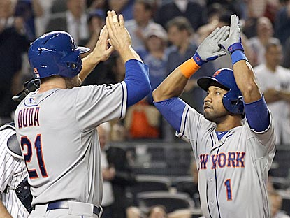 After Chris Young (right) hits a tie-breaking home run in the eighth inning, Lucas Duda turns a game-ending 3-5-3 double play.  (USATSI)