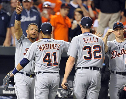 Miguel Cabrera (far left) and the Tigers celebrate following their ninth-inning rally against the Orioles.  (USATSI)