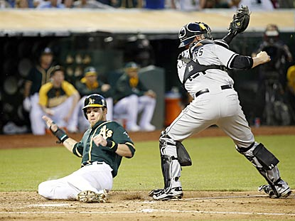 Josh Reddick slides home safely past Chicago catch Tyler Flowers on Craig Gentry's single in the fourth inning.  (USATSI)