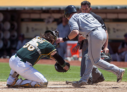 A's catcher John Jaso tags Chicago's Gordon Beckham out at the plate as the two collide during the fifth inning. (USATSI)
