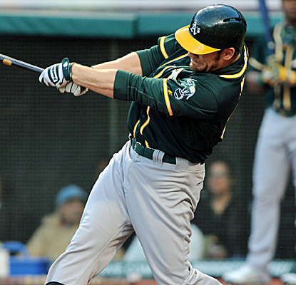 Brandon Moss connects for a two-run homer, helping the A's to their eighth win in nine games.   (USATSI)