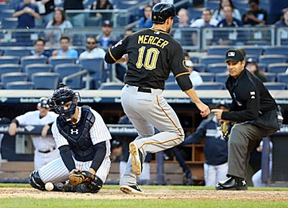 John Ryan Murphy can't come up with the ball, which allows Pittsburgh's Jordy Mercer to score an insurance run in the ninth.  (USATSI)