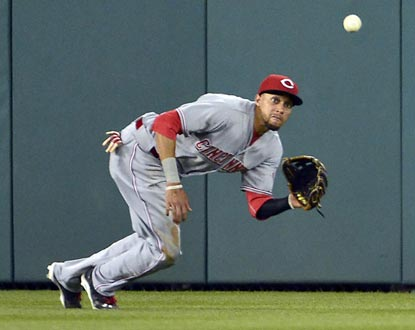 Cincinnati's Billy Hamilton makes a diving catch of Anthony Rendon's line drive to end the bottom of the 14th inning.  (USATSI)
