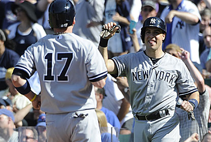 Brendan Ryan (left) scores on Jose Veras' wild pitch as part of the New York 13th-inning rally. (Getty Images)