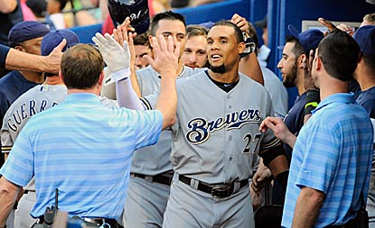 The Brewers dugout is a happy place after Carlos Gomez extends the lead with a two-run home run in the sixth inning.  (USATSI)