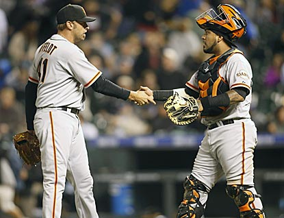 After seeing two Giants pitchers leave with injuries, catcher Hector Sanchez celebrates the final out with Jeremy Affeldt.  (USATSI)
