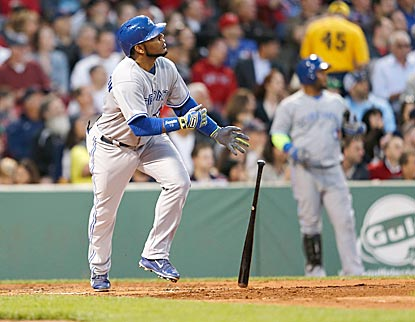 Edwin Encarnacion follows the flight of his second home run, which pushes Toronto's lead to 4-0 in the third inning.  (Getty Images)