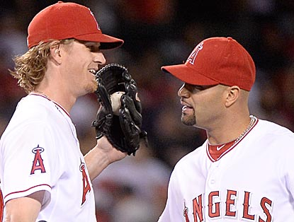 Jered Weaver and Albert Pujols, two of this contest's biggest heroes, celebrate the Angels' victory.  (Getty Images)