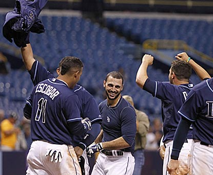 Sean Rodriguez is stripped of his uniform top after giving the Rays the victory with a game-ending home run.  (USATSI)