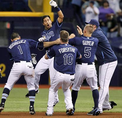The Rays celebrate Cole Figueroa's RBI double in the bottom of the ninth against the skidding Red Sox.  (USATSI)