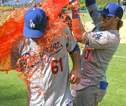 Justin Turner (right) dumps Gatorade over Josh Beckett following the 34-year-old's first career no-hitter in Philadelphia.  (USATSI)