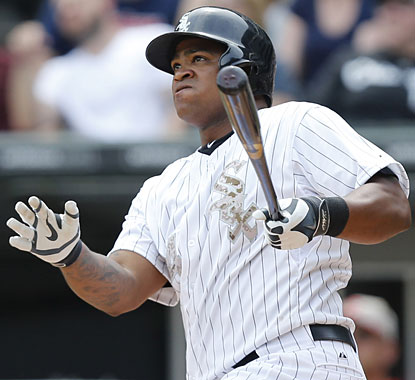 Dayan Viciedo watches as his three-run home run leaves the park in the third inning against the Indians.  (Getty Images)