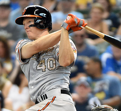 Orioles catcher Nick Hundley singles in the winning run during the 10th inning against the Brewers. (USATSI)