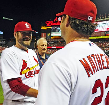 Manager Mike Matheny congratulates Lance Lynn on his first career complete game, a 5-0 win over the Yankees.  (USATSI)