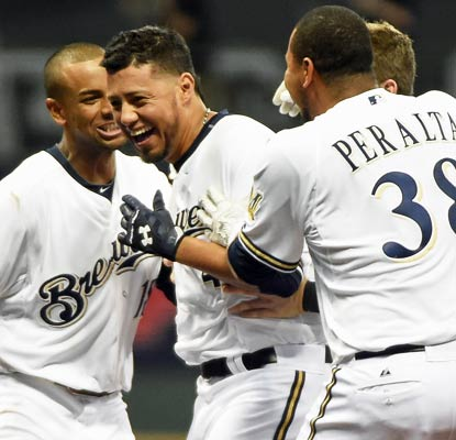 Yovani Gallardo, who is slated to start Wednesday, knocks in the winning run for the Brewers in the 10th inning.  (USATSI)