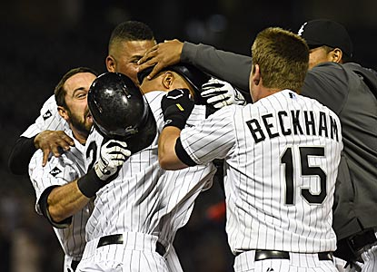 White Sox teammates embrace Moises Sierra after he delivers his first walk-off hit as a big-leaguer.  (USATSI)