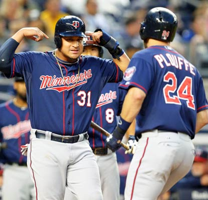 Oswaldo Arcia homers and throws a runner out at the plate as the Twins take down the Yankees in the Bronx.  (USATSI)