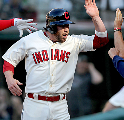 Jason Kipnis scores the winning run in the bottom of the eighth on an opposite-field single by Mike Aviles.  (USATSI)