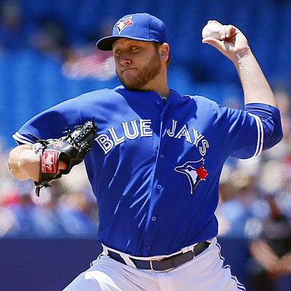 Mark Buehrle walks one and strikes out three in winning his sixth straight game.  (USATSI)
