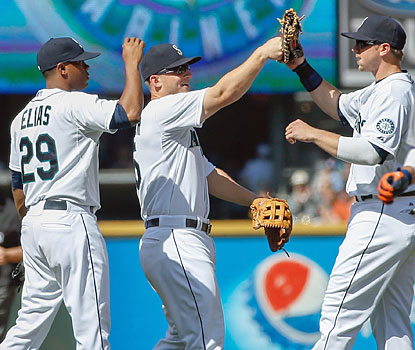 Mariners rookie Roenis Elias (left) notches his first career shutout as he holds the potent Tigers to just three hits. (Getty Images)