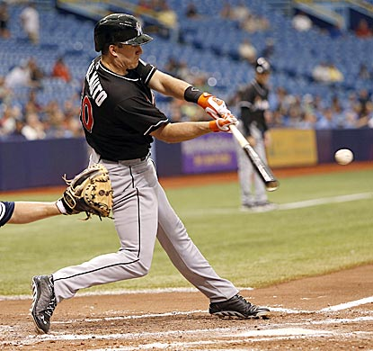 "Miami's Jacob ""J.T."" Realmuto drives in two runs with his first big-league hit -- a single in the fourth inning.  (Getty Images)"
