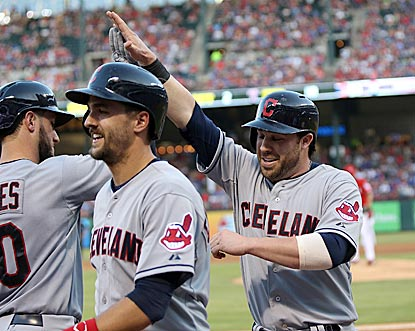 Lonnie Chisenhall receives congratulations in the third inning after belting the first of his three home runs.  (USATSI)