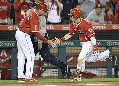 Collin Cowgill ends a long night in Anaheim with a solo shot in the 14th inning -- his first walk-off blast in the bigs. (USATSI)