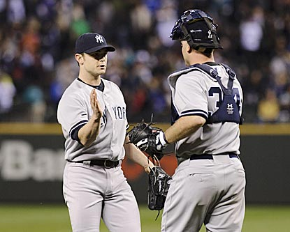 Yankees catcher Brian McCann congratulates closer David Robertson for striking out the side in the ninth inning.  (USATSI)